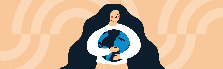 Femme qui prend la planète dans ces mains
